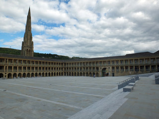 the piece hall in halifax a former eighteenth century cloth hall and public square with old church behind