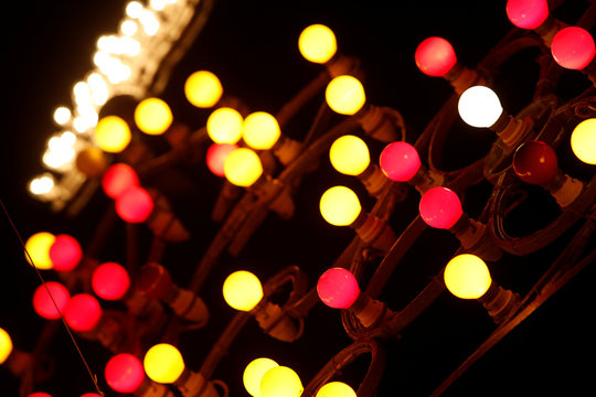 Coloured light bulbs are used in decorative street lighting during week-long celebrations marking the feast of the Assumption of Our Lady in Mosta