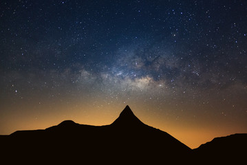 Starry night sky with high moutain and milky way galaxy with stars and space dust in the universe