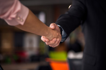 Business agreement. Close up view of business partners shaking hands.