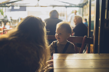 Mother with baby at table in cafe