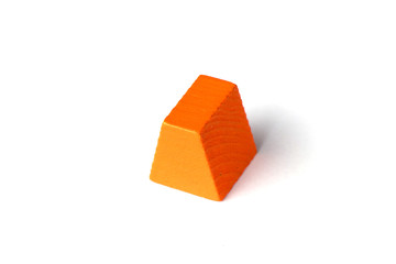 Orange wood trapezoid shape on white background