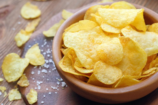 Potato chips in bowl. Fast food.