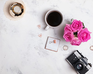 Coffee, roses, retro camera and small gold colored items