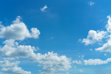 The vast bright blue sky and coulds, nature background.