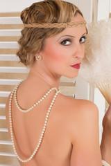 Pearls on nude back