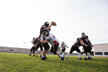 Two teams playing American football on the field