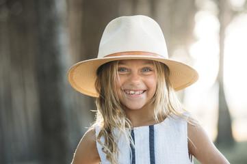 Smiling kid in hat outside