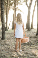 Girl with basket in woods