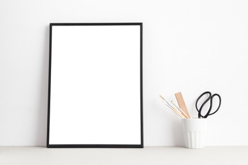 Mock up white poster or picture frame on shelf..