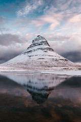 Scenic view of Kirkjufell mountain against cloudy sky