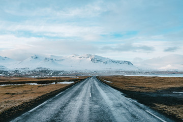 Road in iceland on a cloudy day with mountain in background