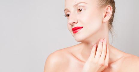 Beautiful woman touching her neck. Perfect fresh skin.  Skin Care