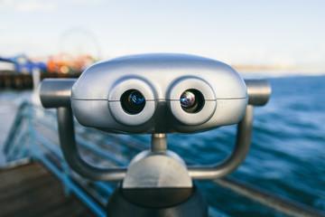 Binoculars on a pier