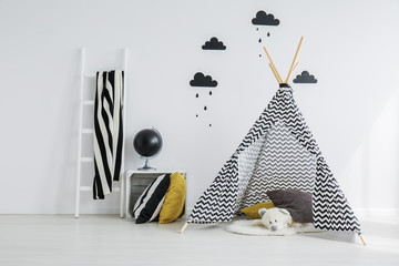 Stylish, patterned teepee in bedroom