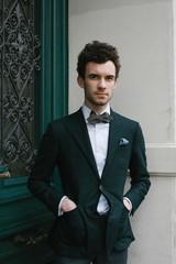 Outdoor Portrait of Caucasian Styler in Green Jacket