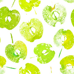 Green halved apples painted watercolor, textured prints. Summer seamless pattern with imprints of apples. Handmade stamp fruits. Vector background