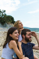 Young people posing on beach