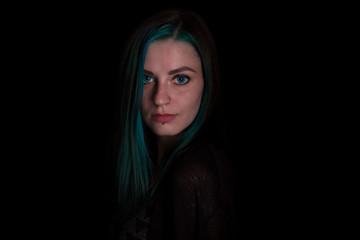 Green eye witch posing in studio