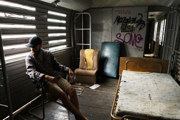 Man sitting in decay house