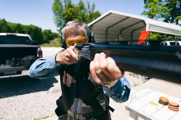 Shooting: Focus On Eyes Of Man Aiming Shotgun