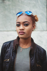 A young woman wearing a leather jacket