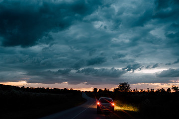 Dramatic sky with car on the road