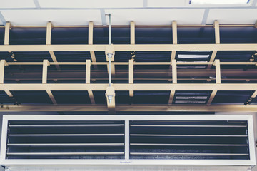 Cable tray with electrical wiring arranged on ceiling ,Cable tray epoxy dark grey : Houses runs of control and power cable used for cable and wire junction distribution and termination.,