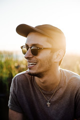 Man Relaxing in Sunglasses and Hat