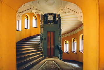 ST.PETERSBURG, RUSSIA - MAY 11, 2015: Old style lift and Staircase in residential building in Saint Petersburg