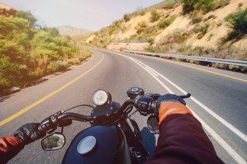 The Road view over the handlebars of motorcycle