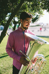Outdoor Portrait of musician with tuba wind musical instrument