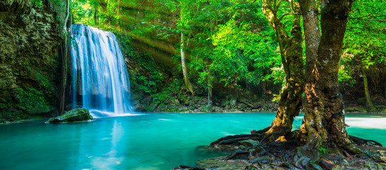 Wall Murals Waterfalls The beautiful waterfall at deep tropical rain forest.