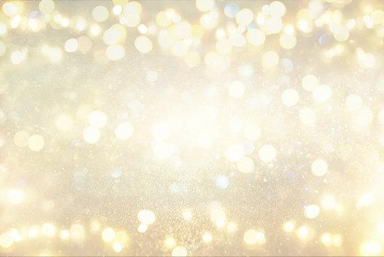 glitter vintage lights background. silver and light gold. de-focused