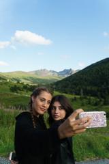 Women taking selfie on meadow