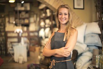 Smiling shop assistant