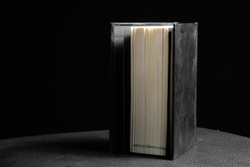 Hardcover book in black background