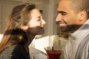 Young couple smiling to each other