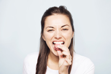 Young woman eating cookie
