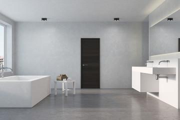 Angular tub, concrete bathroom