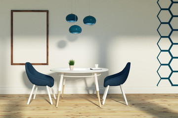 Dining room with blue chairs and a poster
