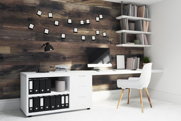 Dark wooden home office, white chair side