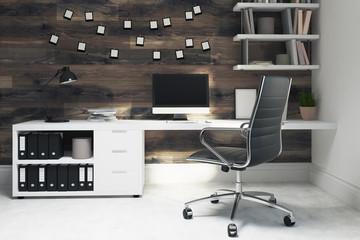Dark wooden home office, black chair, side