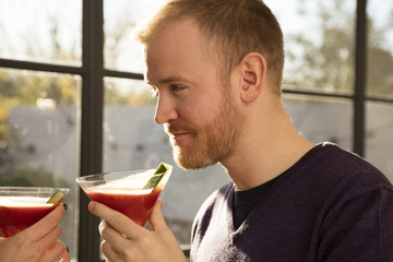 Mid adult man with Bloody Mary