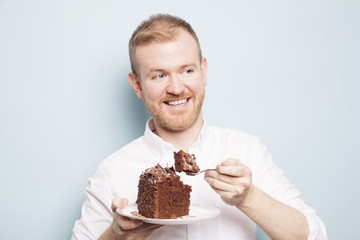 Mid adult man eating chocolate cake