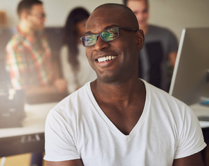 African American businessman smiling in the office