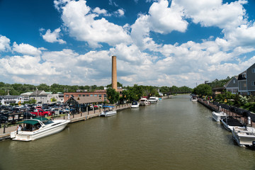 Erie canal with boats and buildings on a summer day in Fairport, New York
