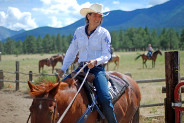 Cowgirl on Brown Horse in Mountains
