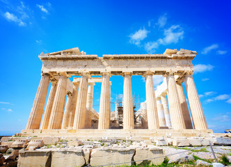 Wall Mural - facade of Parthenon temple over bright blue sky background, Acropolis hill, Athens Greece, retro toned