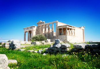 Fototapete - Erechtheion temple with green grass in Acropolis of Athens, Greece, retro toned